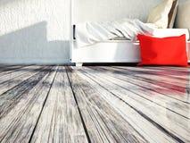 Biały łóżko na drewnianej podłoga Obrazy Royalty Free