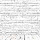 Biały ściana z cegieł pokój z drewnianym podłogowym tłem Zdjęcie Royalty Free