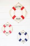 Biały życia boja z powitaniem aboard na biel ścianie Fotografia Royalty Free