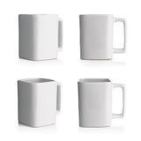 Biały ceramiczny kubek od cztery kątów zdjęcia royalty free