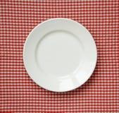 Biały ceramiczny talerz. Zdjęcia Royalty Free