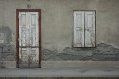 Biały drzwi i biały rocznika okno zamykający obraz royalty free