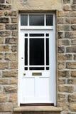 Biały dzwi wejściowy zdjęcie stock