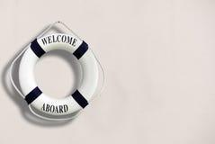 Biały koloru życia buoyancy z powitaniem aboard na nim wiesza na w obrazy stock
