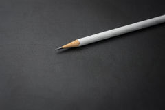 Biały ołówek na czerni Obrazy Royalty Free
