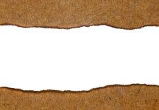 Biały papier rozdziera stawia dalej drewnianego stół Obraz Stock