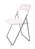 Biały plastikowy falcowania krzesło fotografia royalty free