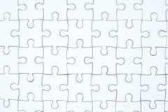 Biały wyrzynarki łamigłówki tło Zdjęcia Stock