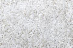 Biała kostrzewiasta dywanowa tekstura Zdjęcia Stock
