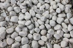 Biała otoczaka kamienia tekstura na ziemi Zdjęcie Stock
