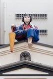Biała twarzy atrapa siedzi na markizie w Tokio Fotografia Stock
