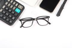 Biały biurko z biurowymi dostawami i laptopem Obraz Stock