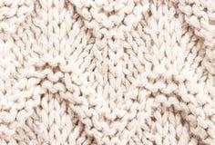 Biała dziewiarska tło tekstura. Dzianiny woolen tkaniny tkanina mu Obraz Stock