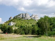 Biaklo - inlier hill located on Cracow Czestochowa upland in Poland. Little Giewont inlier hill with metal cross located in the Sokole Mountains reserve in Krak royalty free stock image