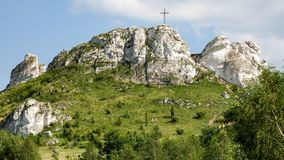 Biaklo - inlier hill located on Cracow Czestochowa upland in Poland. Little Giewont inlier hill with metal cross located in the Sokole Mountains reserve in Krak stock image