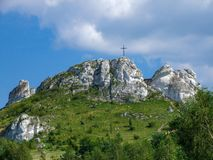 Biaklo - inlier hill located on Cracow - Czestochowa upland in Poland. Little Giewont inlier hill with metal cross located in the Sokole Mountains reserve in royalty free stock image