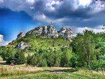 Biaklo - inlier hill located on Cracow - Czestochowa upland in Poland. Little Giewont inlier hill with metal cross located in the Sokole Mountains reserve in stock photo