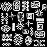 Biali Afrykańscy motywy ustawiający nad czarnym tłem Obraz Royalty Free