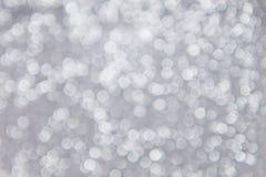 Biali defocused światła na popielatym tle Zdjęcie Stock