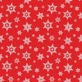 Biali płatki śniegu śnieżni na czerwonym tło zimy bożych narodzeń wzorze Zdjęcia Stock