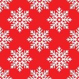 Biali płatki śniegu na czerwonego tła bezszwowym wzorze Zdjęcie Royalty Free
