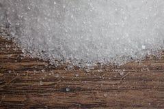 Biali sugars na drewno stole zdjęcie stock