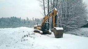 BIALKA TATRZANSKA, POLAND - FEBRUARY 3, 2018. A Caterpillar CAT crawler excavator in the snow Royalty Free Stock Photos