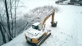 BIALKA TATRZANSKA, POLAND - FEBRUARY 3, 2018. Aerial view of a Caterpillar CAT crawler excavator in the snow Royalty Free Stock Images