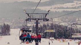 BIALKA TATRZANSKA, POLAND - FEBRUARY 3, 2018. Mountain chairlift and a ski slope Stock Photography