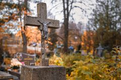 Damaged cross at cemetery in Bialowieza in eastern Poland stock photos