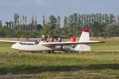 Bialystok, Poland, July 24, 2016: Pilots tow glider after landing Royalty Free Stock Images