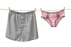 Biancheria intima che appende su un Clothesline Immagine Stock