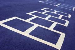 Bianco del gioco di Hopscotch sull'azzurro Fotografie Stock Libere da Diritti