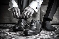 Bianco del nero di scarpe degli uomini Immagine Stock