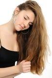 bianco di posizione piacevole della ragazza di modo della priorità bassa Fotografie Stock