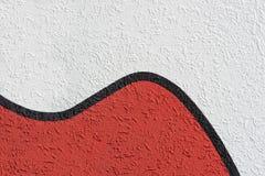 Bianco e rosso intonachi a rustico con la linea nera del separatore fotografia stock libera da diritti