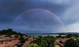 Biandronno, rainbow over Varese lake Stock Image