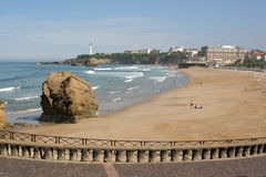 Biarritz beach in low season. Famous Biarritz beach, France, in low season. Prominent building: Hotel du Palais, Winner of the International Senses Wellness Stock Photos