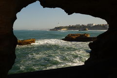Biarritz Lighthouse through hole in rock Stock Photo