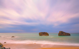 The Biarritz Twins. A long exposure photo of the rocks in the sea for the coast of Biarritz in the south west of France at the end of the afternoon when the Stock Image