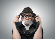 Bias girl driver with a steering wheel Stock Photo