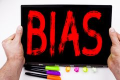 Bias text written on tablet, computer in the office with marker, pen, stationery. Business concept for Prejudice Biased Unfair Tre. Atment white background with Stock Image