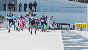 Biathletes before firing line at Biathlon  Men's 18 km Mega Mass Royalty Free Stock Photography