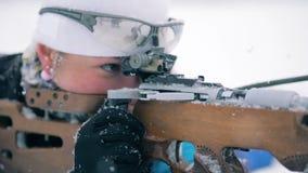 Biathlon riffle is getting reloaded by a sportswoman while lying. HD stock video