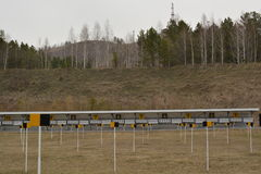 Biathlon shooting range field in the spring Royalty Free Stock Photography