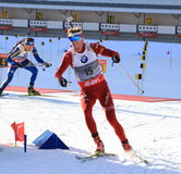 Biathlon, Tarjei Boe from Norway. Tarjei Boe fighting for a new victory in Holmenkollen March 2013 Royalty Free Stock Photo
