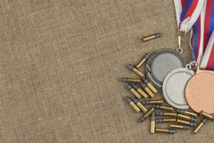 Biathlon victory. Ammunition and winners medals in biathlon. Diploma of shooting competitions. Stock Photos