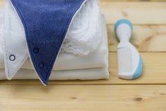Bib, пеленка и гребень Стоковое Фото