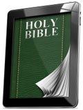 Bibbia - computer della compressa con le pagine Fotografie Stock
