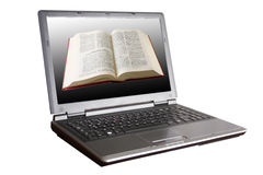 Bibbia in un computer portatile Immagini Stock